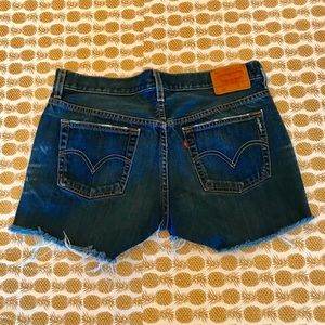 Levi 501 Button-Fly Cut Off Frayed Jean Shorts.